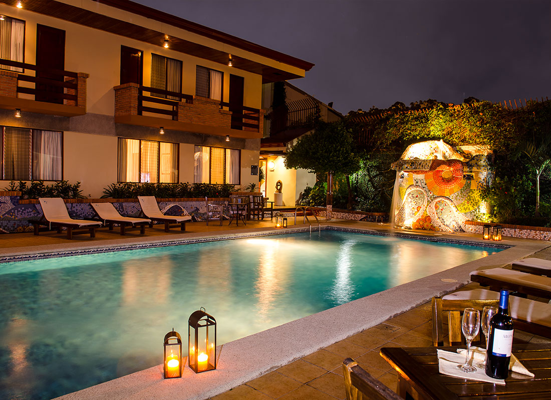 Pool and wine at night