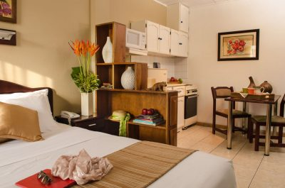 The Studio has a queen size bed as well as a dinning-kitchen area in the same quarter.